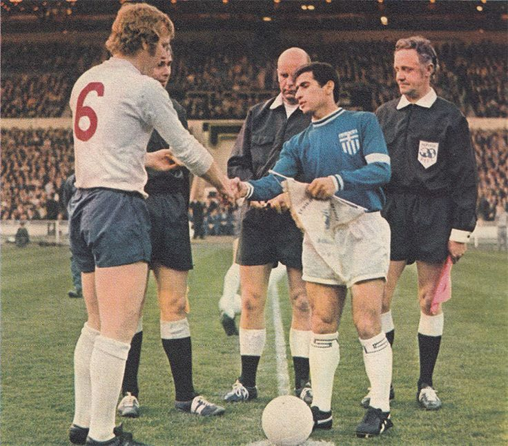 21st April 1971. England captain Bobby Moore shaking hand Greek captain Mimis Papaioannou prior to their Nations Cup match, at Wembley.