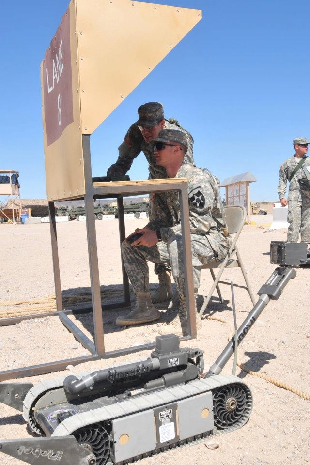 FORT IRWIN, Calif. – Pvt. Nicholas Pirolli and Pfc. Steven Taylor, both with Company B, 4th Battalion, 9th Infantry Regiment, prepare to take their iRobot Packbot 510 down a training lane during a robotics class here, June 4. The Soldiers, assigned to 4th Stryker Brigade Combat Team, 2nd Infantry Division, are participating in the training as a part of Reception, Staging, Onward Movement, and Integration (RSOI) for their rotation at the National Training Center here.