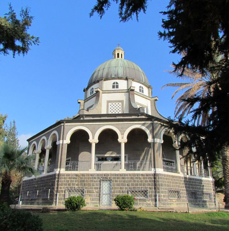 Church of the Beatitudes, by the Sea of Galilee, Israel.  The floor plan is octagonal, the eight sides representing the eight Beatitudes. The church is Byzantine in style with a marble veneer casing the lower walls and gold mosaic in the dome. In front of the church are mosaic symbols on the pavement representing Justice, Prudence, Fortitude, Charity, Faith, and Temperance.