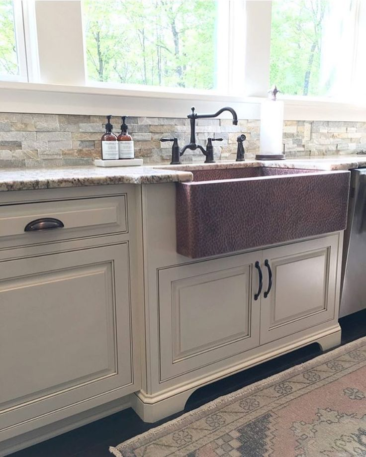 Modern Farmhouse Kitchen With Copper Sink And Vintage Rug