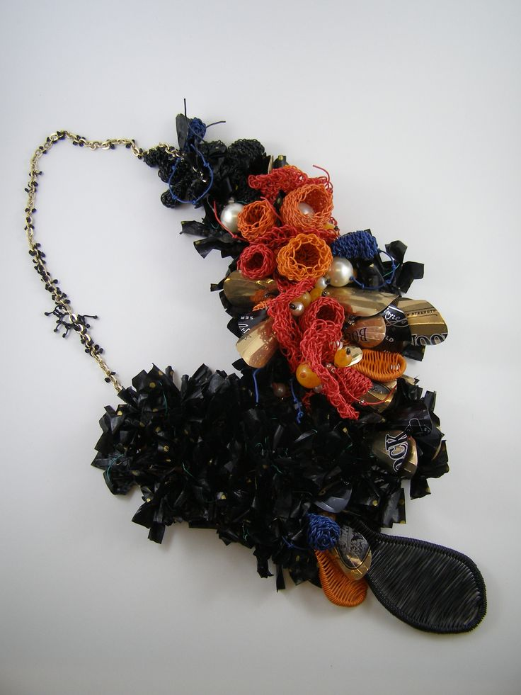 "Pennie Jagiello, ""De-Pendant"", all recycled electrical wire, aluminium, cans, plastic bags,  costume jewellery and fishing rope."