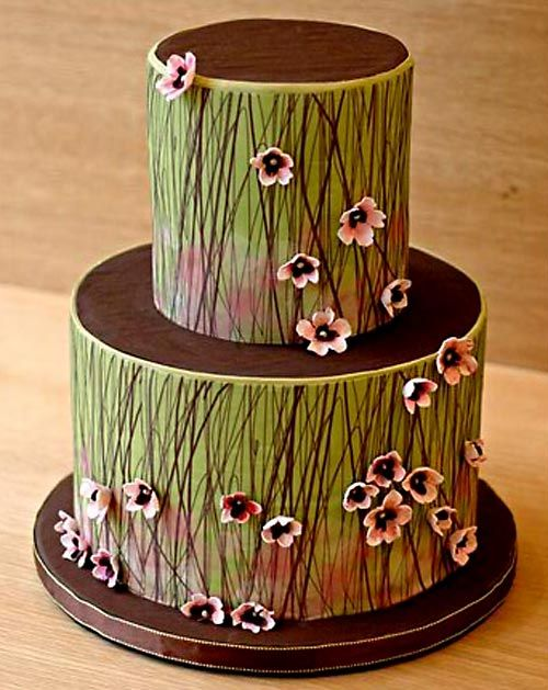 Gorgeous stylized painted 'grass' wedding cake! Studded with pink flowers and each layer topped with solid brown 'dirt.' Sophisticated and outdoorsy. My second choice to the birch tree design.