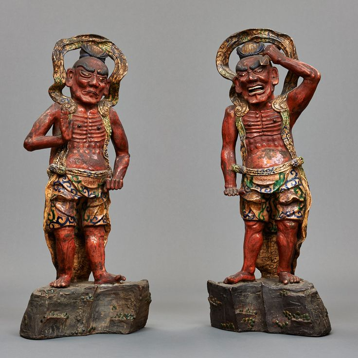Extremely rare set of two polychrome stoneware Nio Guardians, muscular guardians, their bodies red glazed; their clothing in a white glaze with some blue and green decoration. Nio stand at the entrance of many Buddhist temples and are both manifestations of bodhisattva Vajrapani. One called Agyo, with open mouth wielding a tokkosho-weapon. The other called…
