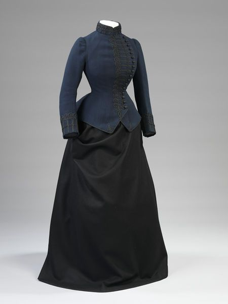 1885-86 Woman's Riding Outfit. Jacket of flannel trimmed with mohair and lined…