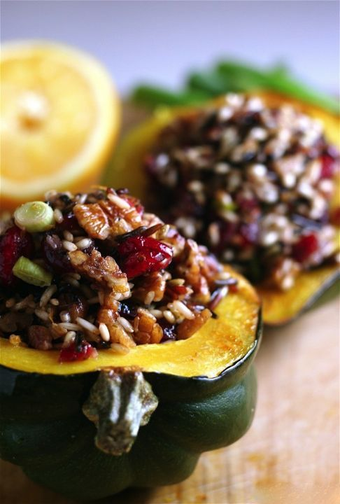 Baked acorn squash stuffed with wild rice, toasted pecans, and dried cranberries. I think I'll add some sautéed mushrooms to this!