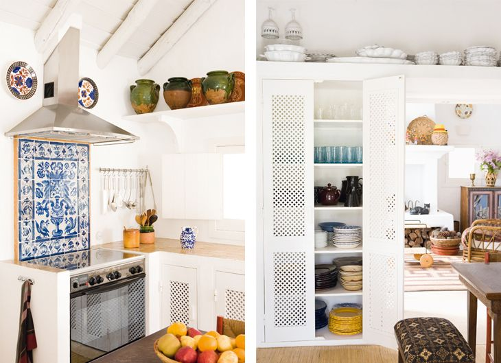 Love this look, if we lived in a warm climate like Greece! :) I love the back splash tiles, the earthenware, the exposed beams, and the cool cabinet doors.