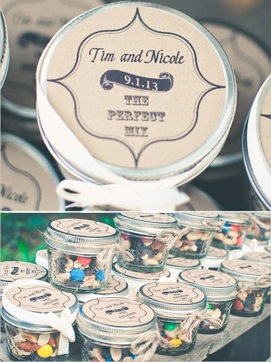 Miniature glass mason jar filled with trail mix and topped with DIY personalized favor label.