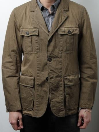 Unlined safary jacket C.P. Company - khaki color Jacket made of cotton and nylon. Four patch pockets with bellows. Three-button closure. Cuffs with slits. Washed fabric distressed. C.P. Company Spring Summer 2013 Collection.