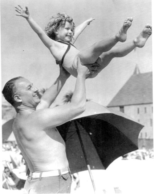 One of the few pictures of Shirley Temple when she wasn't working and it's with her father. God Bless Her.