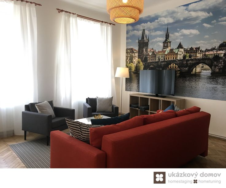 Decorating project for Airbnb apartment in Prague, Czech Republic #livingroom #orange #sofa #mirror #airbnb #prague #wallpaper #praha #czechrepublic #czech