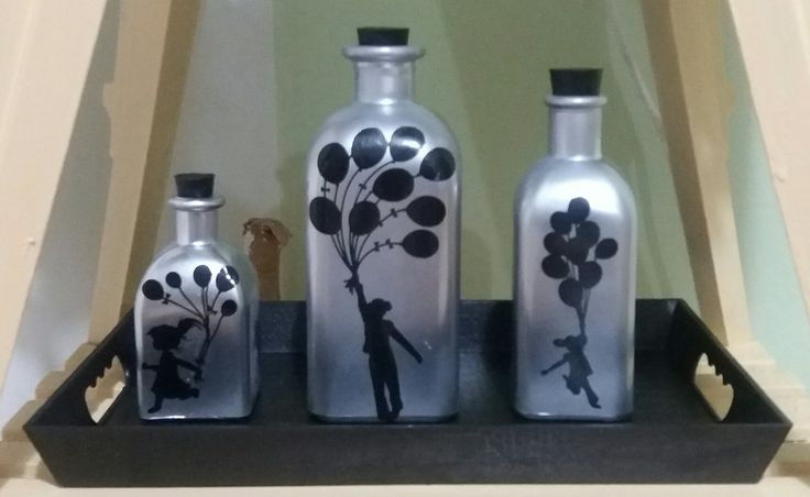 DIY silver bottles. Recycle your old bottles by spray painting them silver and adding some stickers.