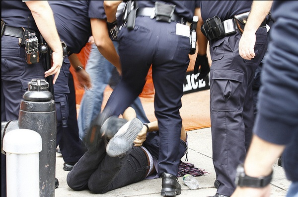 32 Pictures Of Police Brutality From Occupy Wall Street Protests. Something is so wrong about this pic