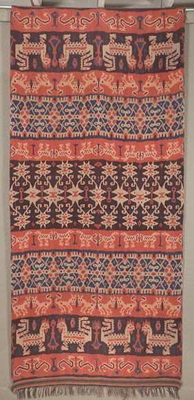 "Hinggi  Sumba. Indonesia  45""x 95""plus fringe.  Warp ikat. Cotton.  This ikat is dyed with the traditional indigo and kombu dyes."