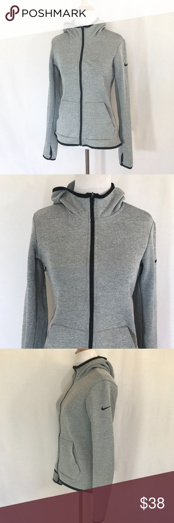 Nike - Therma Dri-Fit Training Hoodie in Gray Excellent condition Nike Womens Therma Training Hoodie.  Offers the warmth of Nike Therma fabric with a water-repellent finish that helps keep you dry in light rain. Nike Therma fabric helps manage your bodys natural heat to keep you warm.  Water-repellent finish helps to keep you dry. Underarm gusset offers a comfortable range of motion. Full-front zipper for easy on and off. Thumbholes at the sleeve cuffs enhance coverage. Front kangaroo…