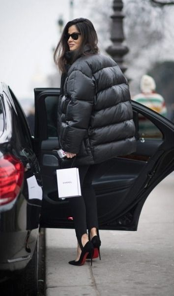 If the asymmetrical puffer coat is a little too extreme for your taste, why not try this jet-black version paired with stirrup pants and killer pumps?