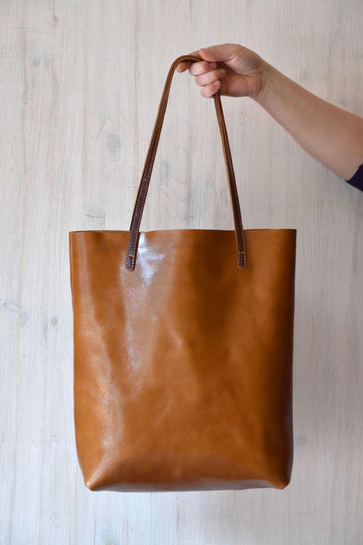 Minimalist handmade leather tote bag. Simple and stylishly functional.