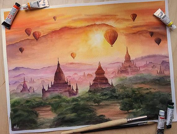 Hypnotizing and mysterious plains of Bagan, Myanmar with floating air balloons at sunset :) When I was painting this landscape I wanted to represent those magnificent golden hours before sunset)  Size: 15,74 x 11,81 inches (40 х 30 cm, including white frame – 1 cm) Medium: lightfast