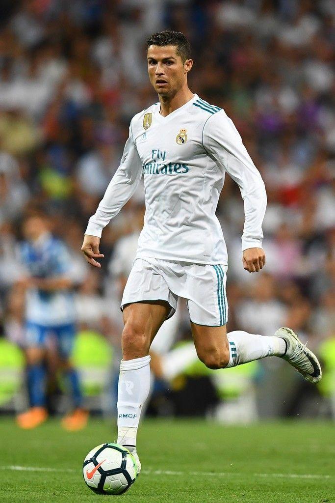e5afa84c1 Real Madrid s Portuguese forward Cristiano Ronaldo controls the ball during  the Spanish league  football match Real Madrid CF vs Espanyol at the  Santiago ...