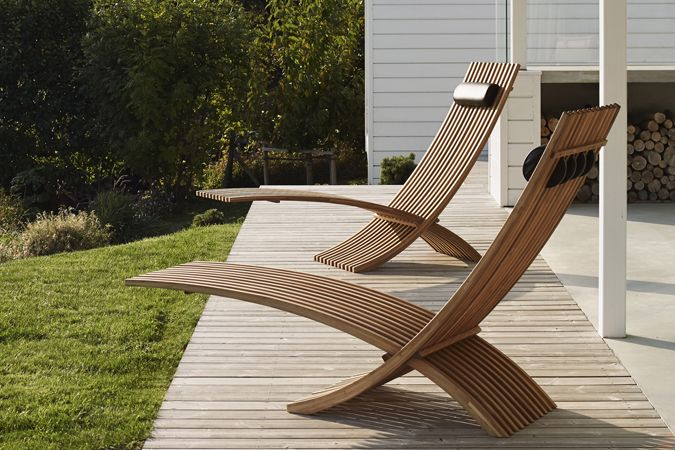 Sophisticated teak lounge chair with elegant silhouette