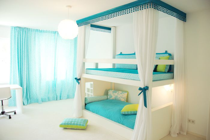 Transform basic bunk beds into something more fabulous w/this cornice and drapery panels. Love the aqua & green. #girlbedroom