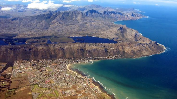 Aerial view of Gordon's Bay, Strand and Steenbras Dam - Cape Town. This picture by Maria Wegner also gives a brilliant perspective on the beautiful Clarence Drive along the Hottentots-Holand mountain range and the Kogel Mountain nature reserve up to Rooi-Els and Kleinmond  on the horison.(photo by Maria Wagener)  #Strand #GordonsBay #Rooiels #Kleinmond