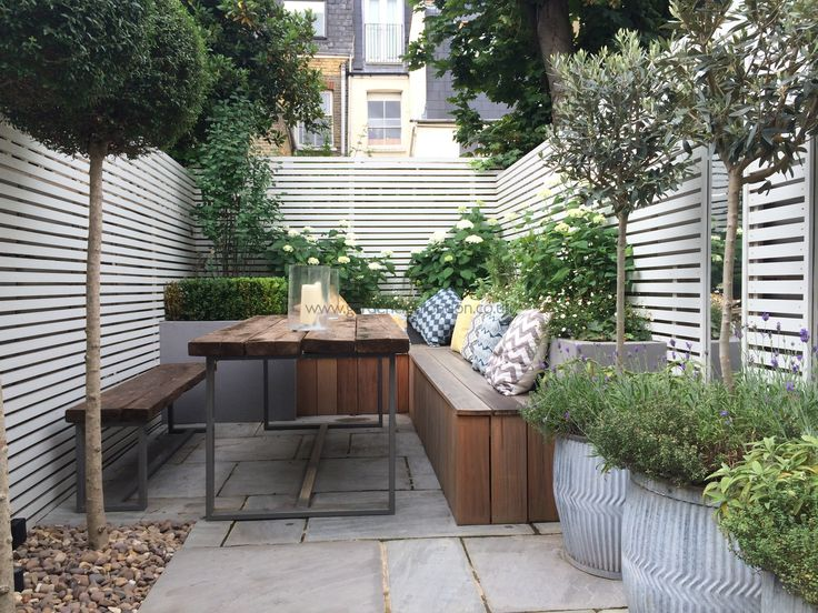 Contemporary wooden table and benches rear garden design London