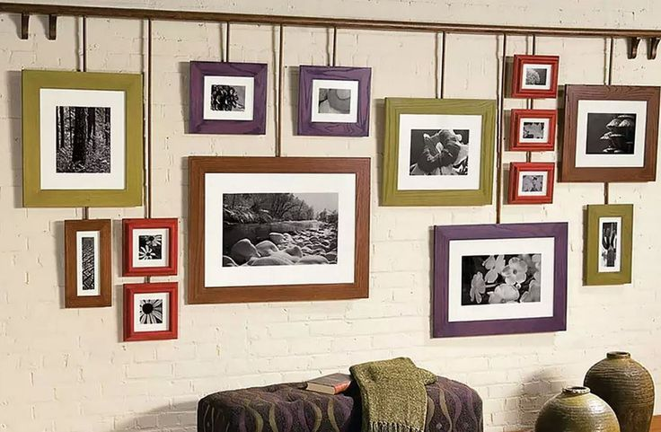 Turn a blank wall into the center of attention. A customized photo gallery can add flair to any room! For a similar look, use #Minwax Water Based Wood Stains in a range of decorative colors. Pictured here is, China Red, Botanical, Toffee, and Royal Mahogany. #WallArt #PictureFrames #Photos