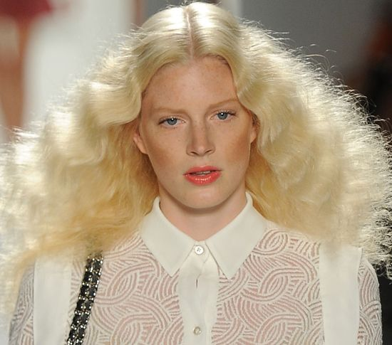 Brushed out curls    The 70s are still influencing hair and I love these brushed out curls at Rebecca Minkoff. Embrace your natural frizz with this big hair. Add a smooth centre part so it looks like you meant it.