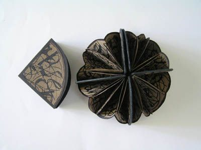 The Flowers of Evil by Helen Malone. 2006. Quarter circle book. Eight circular folded pages containing Baudelaire's text of 'The Flowers of Evil' (Les Fleurs du Mal) written expressively in walnut ink. 8 cm x 8 cm x 2.5 cm. Edition of 5.