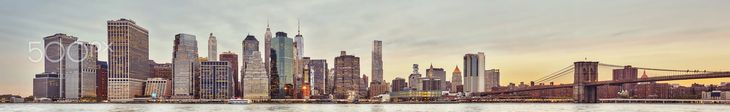 High quality mega panoramic picture of the Manhattan skyline at sunset, New York City, USA.