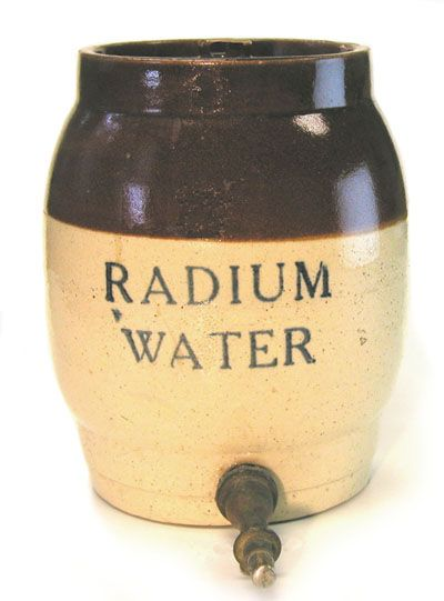 "1920's-30's Radium water for 'healthy' radioactivity. The source of the radioactivity is a circular disk that would normally be kept inside the jar. The disk for this jar was identified as the ""Hammer Radium Activator."""