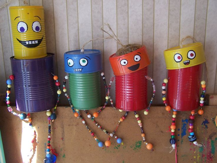 Upcycled Tin Can Man Windchime Garden Art Decoration by SquiggaSquirms on Etsy https://www.etsy.com/listing/157862350/upcycled-tin-can-man-windchime-garden
