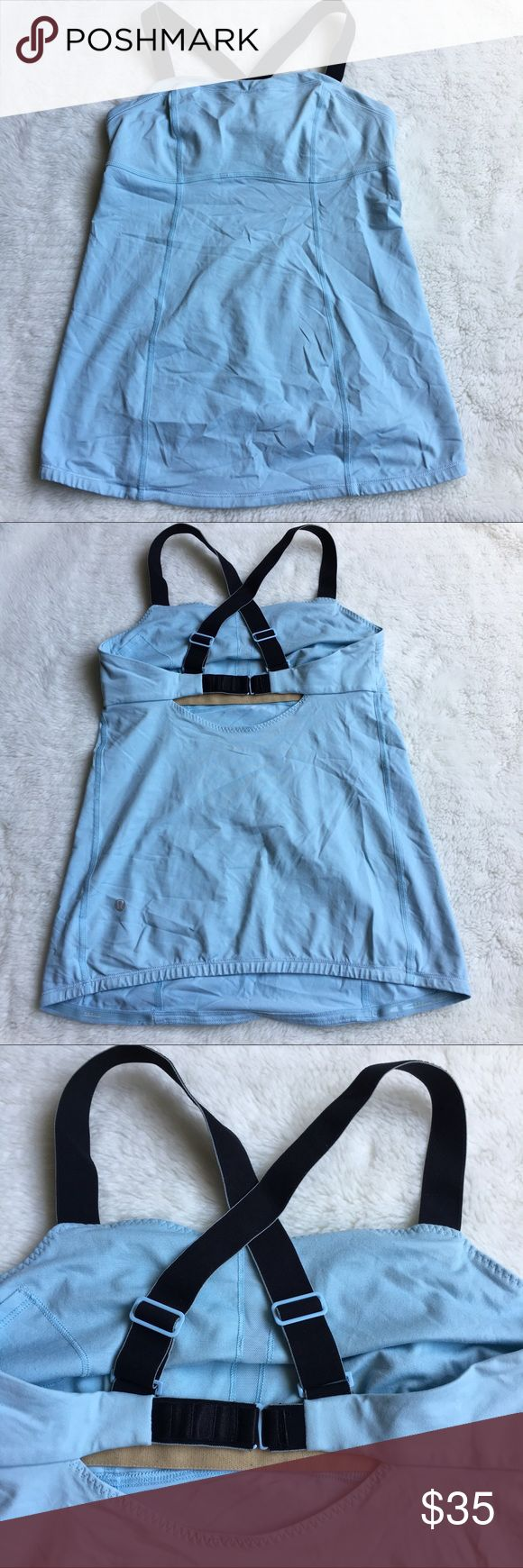 Lululemon Light Blue and Black Crossed Back Top 6 Preowned lightly worn Lululemon Light blue Crossed Back Top size 6. Has builtin bra. No pads. Adjustable straps.  Please look at pictures for better reference. Happy shopping! lululemon athletica Tops Tank Tops