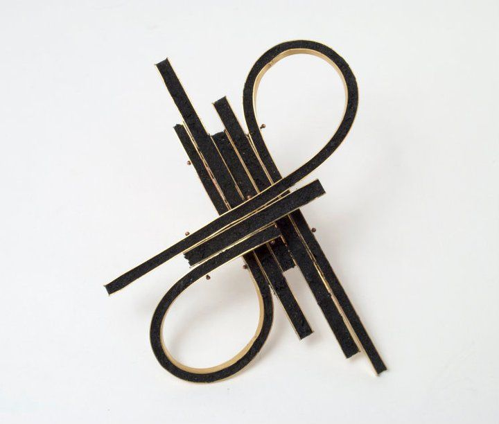 Andrea Zeuner  -- Superhighway Brooch 2011  Brass, asphalt crack repair, steel