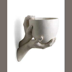 A Richard Etts molded plaster Hand sconce  1974  signed in the mold with a C within a circle and 1974 RICHARD ETTS
