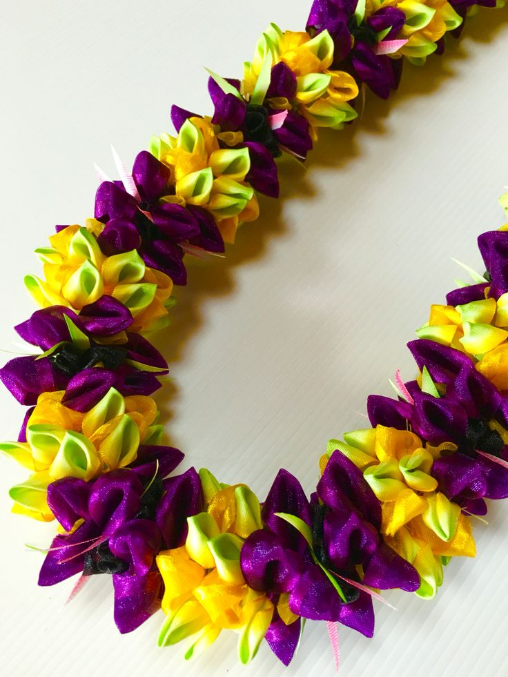 Plumeria with Purple flower (Ribbon Lei) designed by Tracy Harada Ui'mauamau