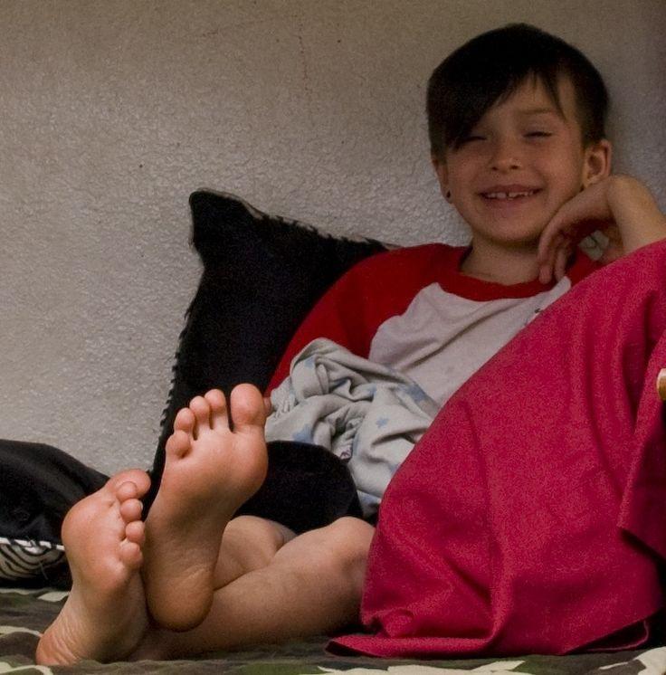 young boys bare feet