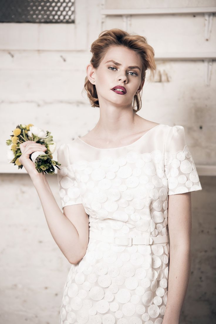 Modern wedding dress for the contemporary bride. Emily dress - Muscat Bridal. Circle embroidery net dress with scallop detail.