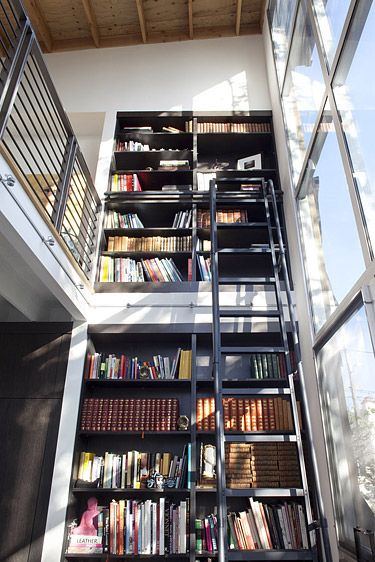 Aww I've always wanted a bookshelf like this with a ladder.. I just need to increase my book selection by a lot.. :(