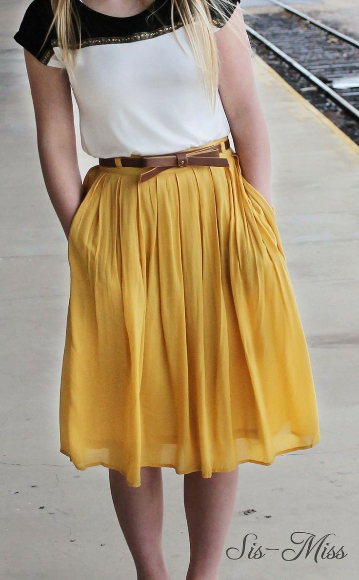 I like the whole outfit, but my favorite thing is the skirt. It's lightweight, and flowy and has pockets. It's a nice color too.