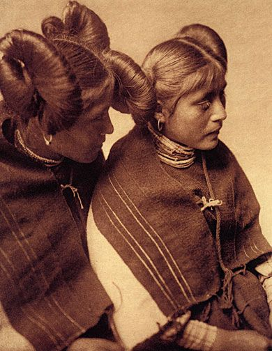 Two Hopi women with squash blossom hairstyle.