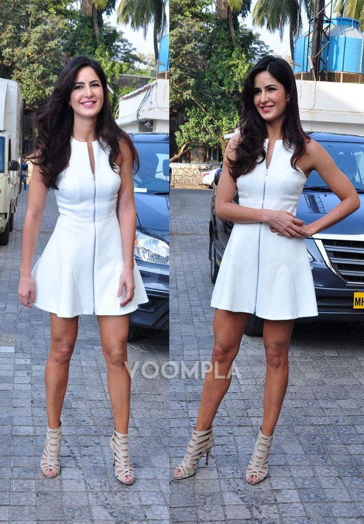 Those legs! Katrina Kaif shows off her toned thighs and legs in a short white dress... so HOT! via Voompla.com