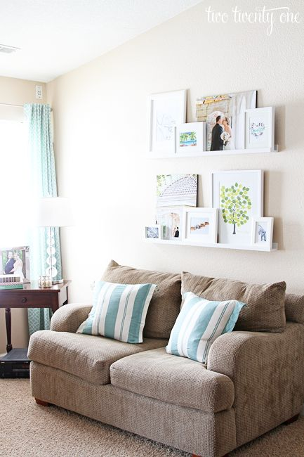Great idea, especially for rooms with tall walls. Picture ledges above sofa.Picture Ledge, Decor Ideas, Decor Living Room Ideas, Decor Living Room Wall, Pictures Ledge, Studios Couch, Gallery Wall, Ikea Pictures Frames Ideas, Living Room Pictures Frames