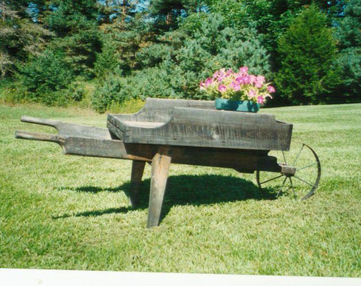http://lizstevens.hubpages.com/hub/Metal-Wheel-Hardware-Flower-Carts-Garden-Carts-Wooden-Wheelbarrow