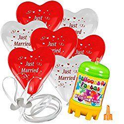 Überrascht das Brautpaar mit roten Herzluftballons, die nach der Trauung in den Himmel steigen - ein tolles Erlebnis für die ganze Hochzeitgesellschaft!