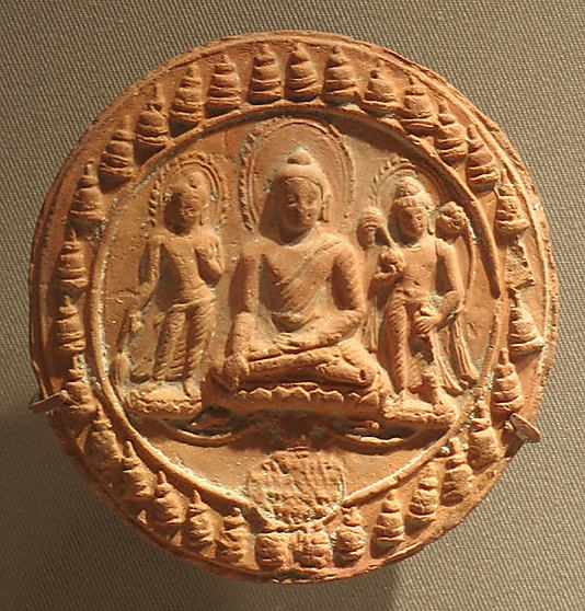 Votive Plaque with Seated Buddha and Attendants,Pala period,11th century India,Bihar. Terracotta