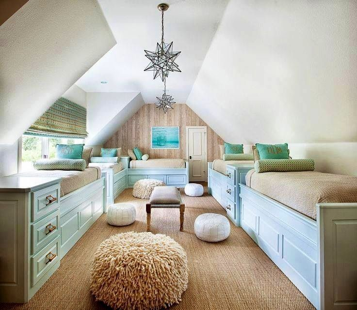 Perfect use of reclaimed attic space for an area with a slanted roofline. Makes a wonderful guest bedroom area for children/teens