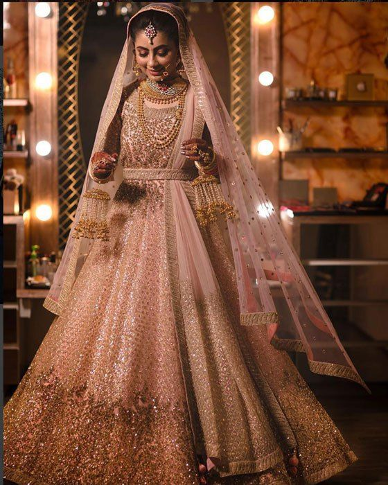 Top Indian wedding trends | Real Indian brides | Beautiful bride in powder pink lehenga with gold effect | Golden chandelier kaleere with pearl strings and jhumkas | Real Indian weddings | Picture Credits: Gautam Khullar Photography | Every Indian bride's Fav. Wedding E-magazine to read.Here for any marriage advice you need | www.wittyvows.com shares things no one tells brides, covers real weddings, ideas, inspirations, design trends and the right vendors, candid photographers etc.