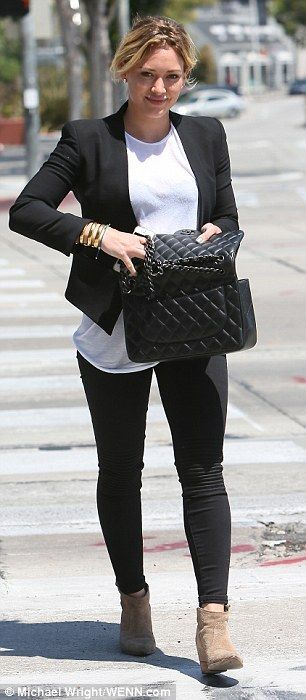 Back to basics: Hillary donned a pair of tight black jeans with ribbed detail on the knees, a loose fit crisp white T-shirt and a black blazer. Watch Hilary on the latest episode of Younger on TV Land at http://www.tvland.com/shows/younger.