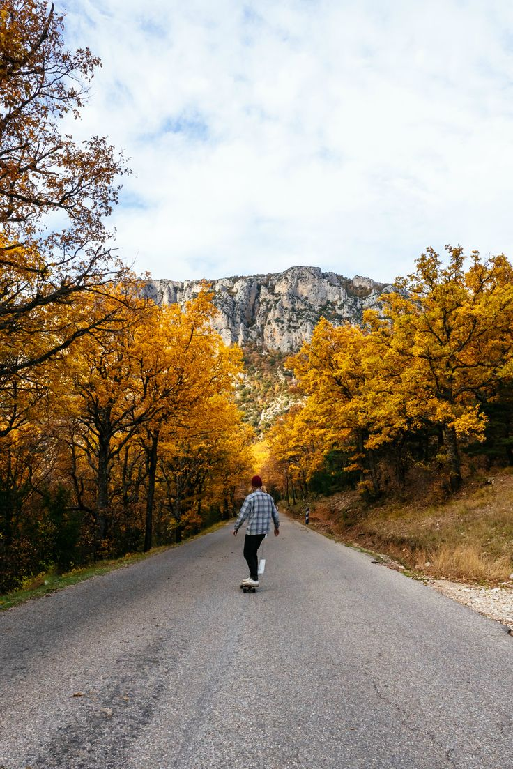 Simple Living inspiration, outdoor adventures on a skateboard. Fall leaves, nature photography. Skating in the mountains of France.